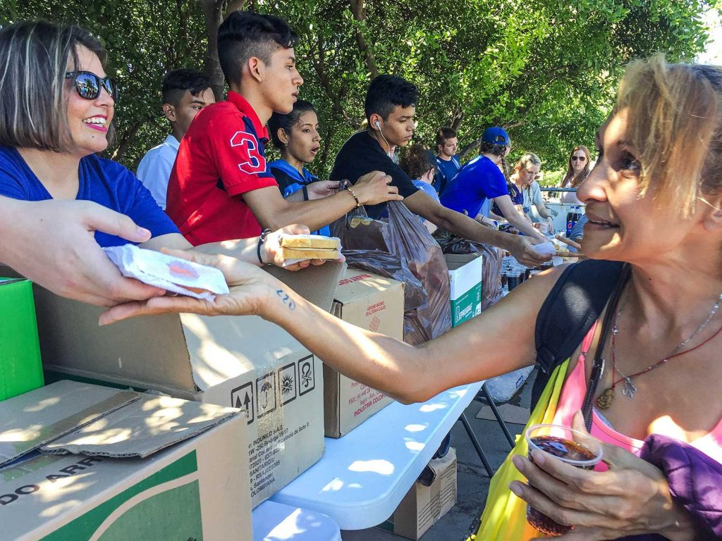 In Cucuta, Colombia, members of Churches of Christ from the U.S. and Colombia give out sandwiches in a public park.