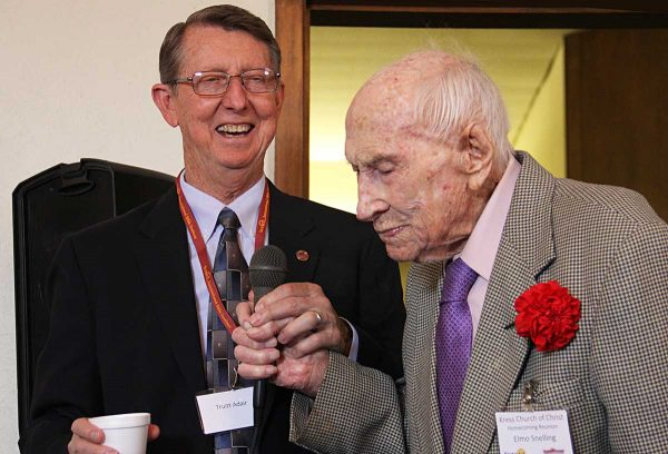 Elmo Snelling shares his favorite Bible verse during a celebration of his 104th birthday as Truitt Adair listens.