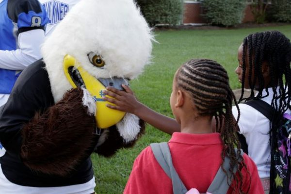 Faulkner University's mascot, Baldwin welcomes Davis Elementary students back to school on Monday.