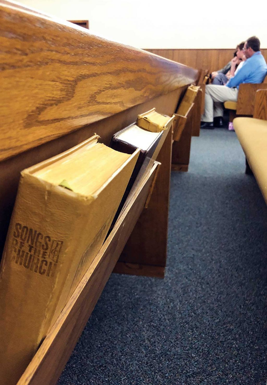 Hymnals line the pews of the Kress Church of Christ. The church, which has seven regular worshipers, swelled to 73 during a recent Homecoming Sunday.