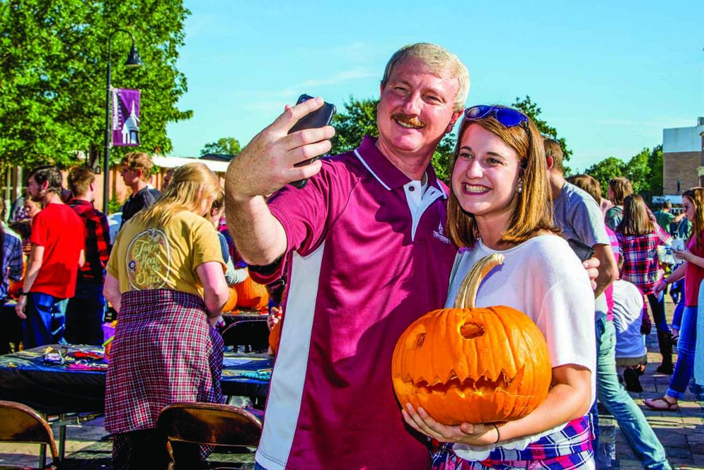 David Shannon snaps a selfie with a Freed-Hardeman student during a fall event.