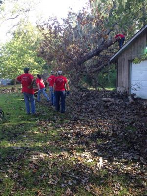 Volunteers with Churches of Christ Disaster Response Team work to clear trees knocked over by the hurricane.