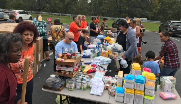 Disaster Assistance CoC sets up supplies outside of a church in Maxton, North Carolina.