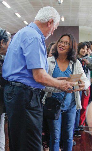 Brian Garnett of Sunset International Bible Institute distributes solar players in Baguio.
