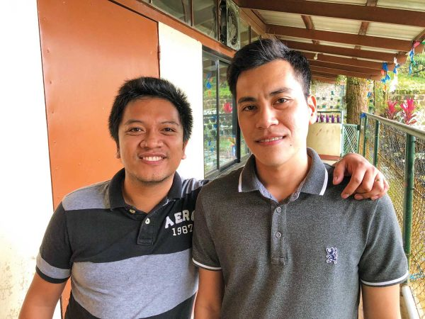 In Baguio, Philippines, Jaydee Tangunan, left, visits with Ed-Mark Delacion after Delacion receives solar player No. 10,000.