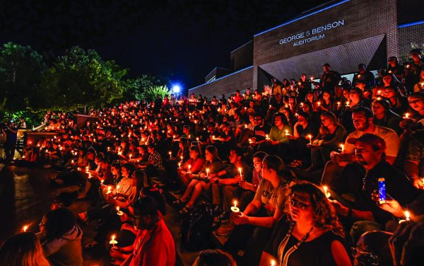 Students, faculty and staff at Harding University in Searcy, Ark., gather Monday night on the Benson Auditorium steps to grieve and remember alumnus Botham Shem Jean.