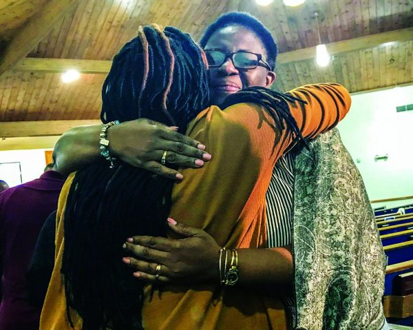 Allison Jean, right, mother of shooting victim Botham Shem Jean, hugs a well-wisher after a prayer vigil Saturday at the Dallas West Church of Christ.