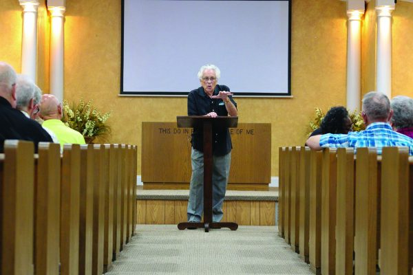 Albert Lemmons makes a point at the 25th annual Prayer Enrichment Workshop at the Calhoun church.