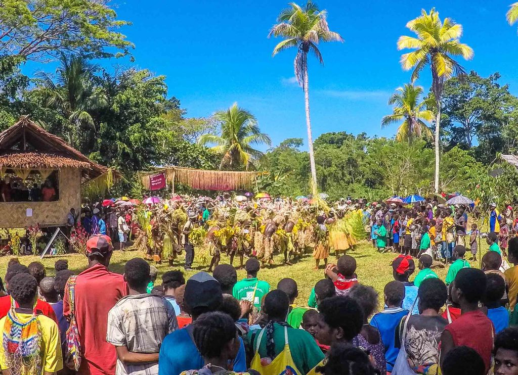 Villagers and traditional dancers in Papua New Guinea celebrate Pioneer Bible Translators' release of the Gospel of Matthew in their native tongue, Mum.