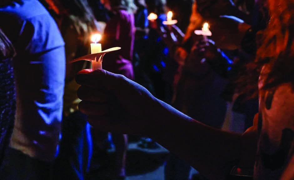 Christians at Harding University in Searcy Ark., light candles and sing hymns in honor of Botham Jean.