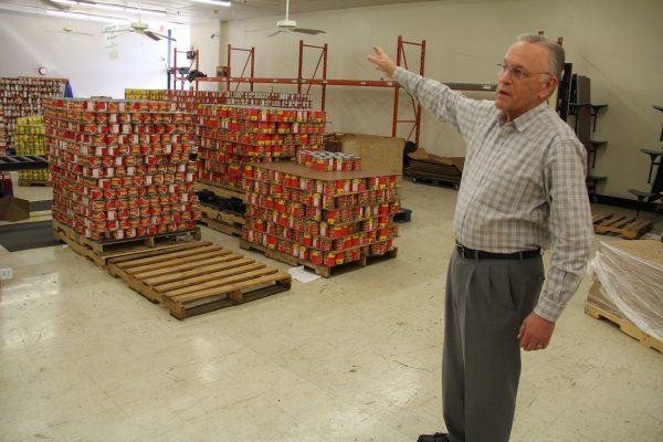 Mike Lewis, executive director of Churches of Christ Disaster Relief Effort Inc. in Nashville, Tenn., gives a tour of the ministry's 87,000-square-foot warehouse.