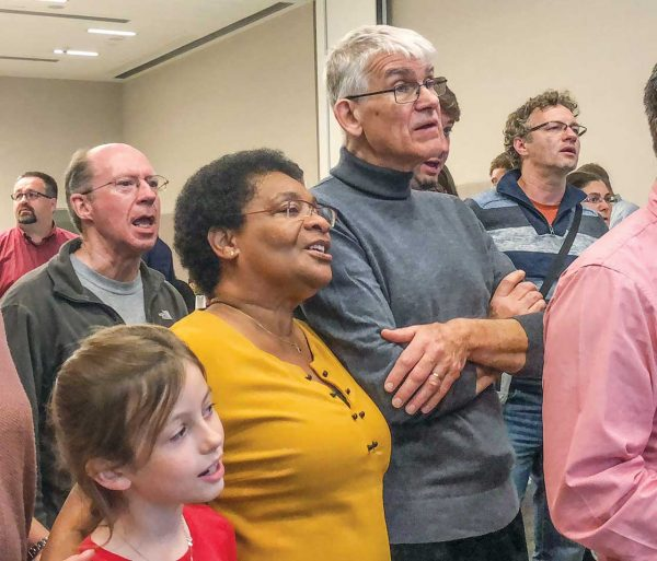 Robert Limb and his wife, Evelyne, sing along with worship leader Keith Lancaster in Bratislava.