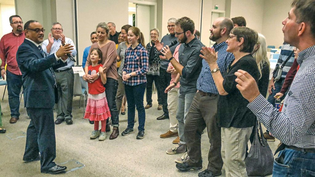 "Dominic dos Santos, director of the Trinidad School of Preaching in the Caribbean, leads Christians from Europe, America, Asia and the Middle East in the song ""Amen"" during the European Vision Worskhop in Bratislava."