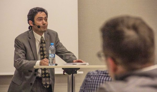 "Wissam Al-Aethawi speaks about ""Islam in Christ's Eyes"" during the workshop."
