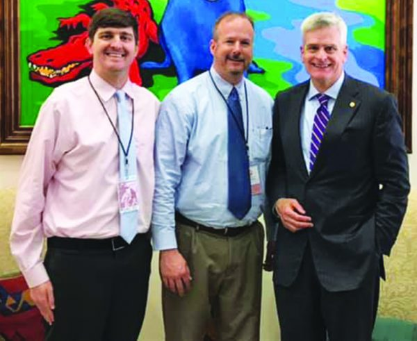 Matt Hollis and Ben Brewster visit with U.S. Sen. Bill Cassidy, R-La.