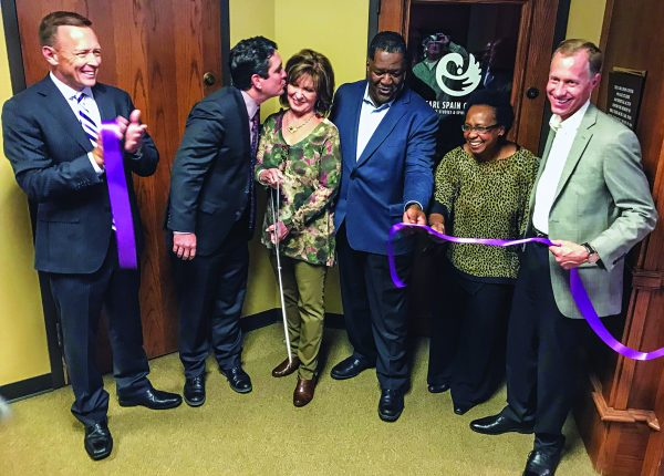 Celebrating the ribbon cutting for the Carl Spain Center for Race Studies and Spiritual Action are, from left, Abilene Christian University President Phil Schubert, Spain's grandson Gavin Rogers, Spain's daughter Claudette Rogers, founding director Jerry Taylor, ACU management sciences professor Orneita Burton and ACU Provost Robert Rhodes.
