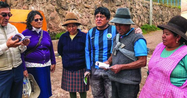 "Hipólito Triveños and his wife, Francisca, left, sing a Quechua-language hymn with members of the Huancalle Church of Christ. At right are Narciso Roya (blue and black stripes), Victor Sisaya and their wives, Felicitas Perez Huaman and Teofila Huaman Garcia. The song depicts the suffereing of Christ, Roya says, and proclaims him ""purchaser"" of our souls."