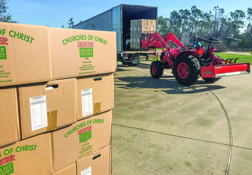 Deacon Austin Boyd uses a forklift-equipped tractor to help unload the disaster relief trailer at the Jenks Avenue Church of Christ in Panama City, Fla.