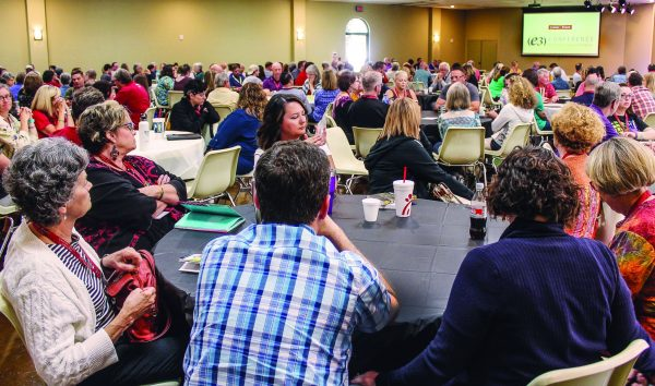 Some of the 350 attendees gather for a presentation at the E3 Conference hosted by the Highland Oaks Church of Christ in Dallas.