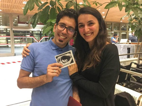Masoud and Mahboubeh show off their first baby photo.