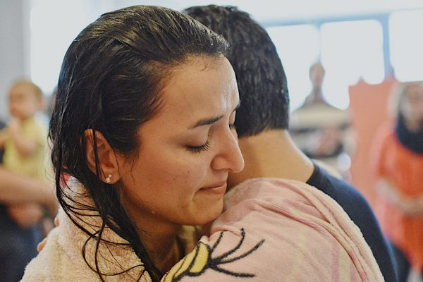 Newly immersed, Mahboubeh embraces her husband, Masoud, after their baptisms in the European city of Vienna, Austria. The couple, refugees from the Middle Eastern nation of Iran, worships with the Danube Church of Christ.