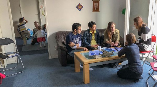 Masoud and Mahboubeh speak with fellow Iranians before Sunday worship with the Danube Church of Christ.