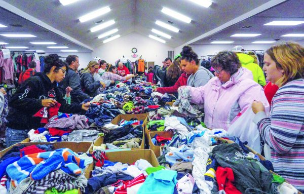 The East Hill Church of Christ gives away clothes to its community twice a year.