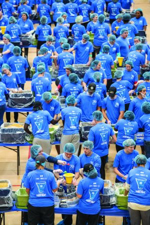 Hundreds of Harding University students donate their time to help pack 254,000 meals in under two hours. Churches of Christ in the area were among those who helped distribute the meals.