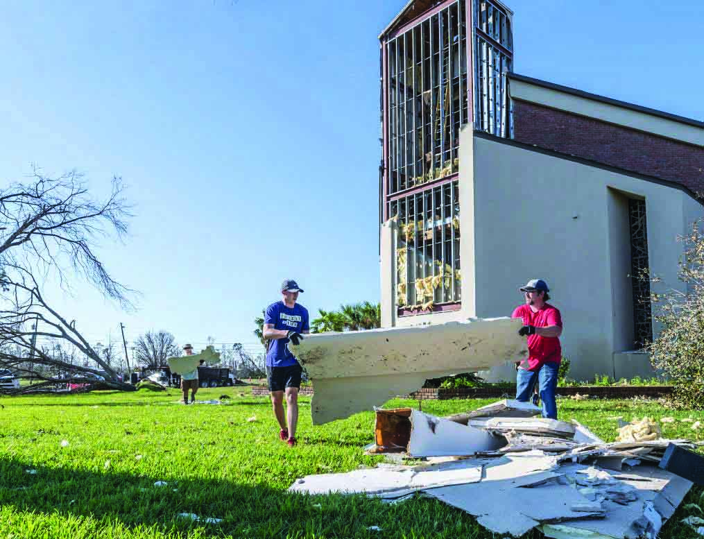 At the damaged meeting place of the Palo Alto Church of Christ in Panama City, Fla., volunteers remove waterlogged drywall.
