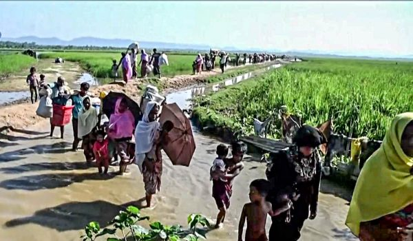 Rohingya refugees enter Bangladesh after fleeing Myanmar in 2017.