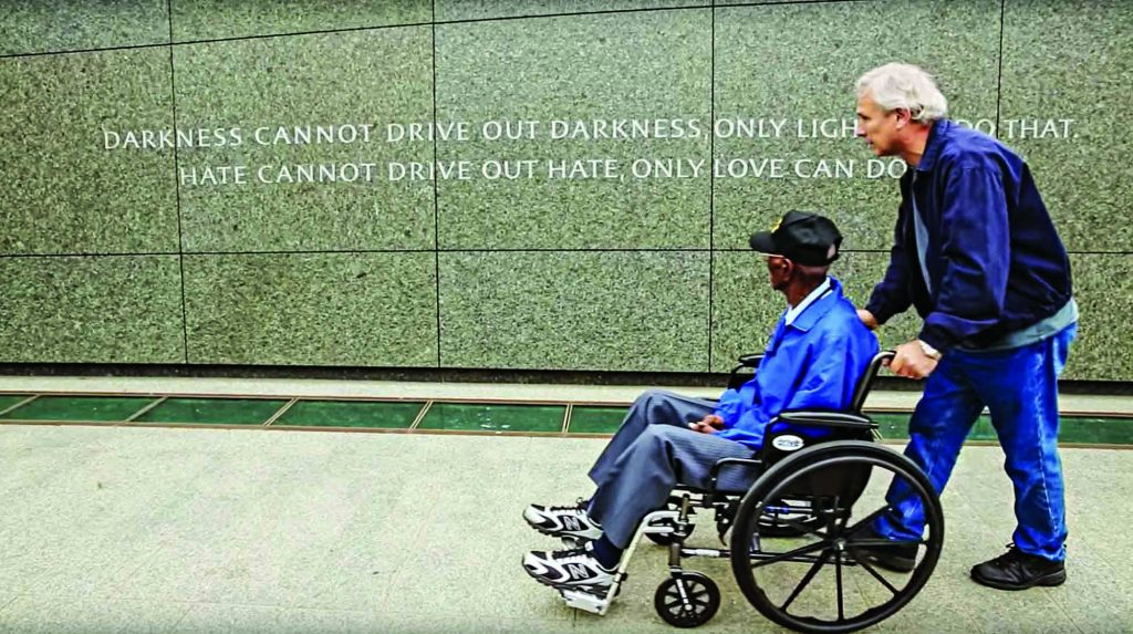 Richard Overton visits the National World War II memorial in Washington during a trip provided by Texas Honor Flights. Pushing his wheelchair is Ron Bell, minister for the Church of Christ in Hyde Park, who baptized Overton.