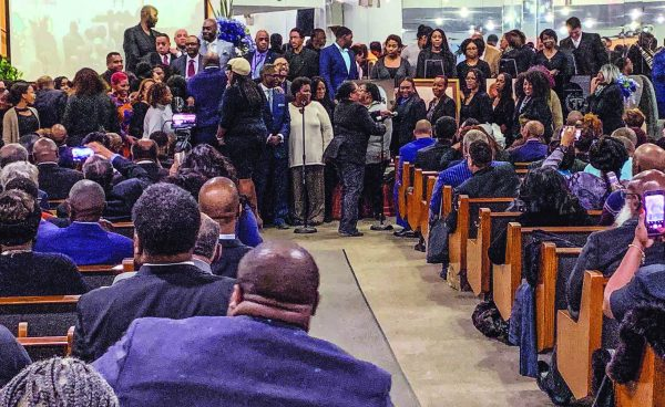 A crowd of church members from across the U.S. gathers in Harlem to remember R.C. Wells.