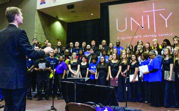 "The Lubbock Christian University chorus and the Fort Worth areawide ""Unity"" chorus join together to sing ""Let It Rise"" in honor of Botham Jean and ""The Lord Bless You and Keep You."" Philip camp directs the combined groups."