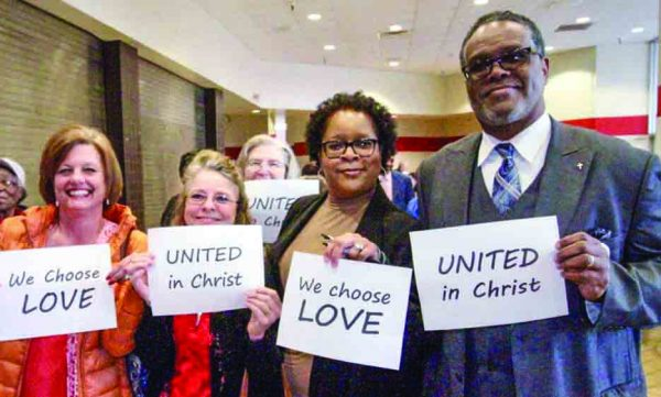Minister Sammie L. Berry, right, joins Glenda White, from left, Lisa Farmer and Joyce Brock of the West Freeway Church of Christ in Fort Worth in touting unity.