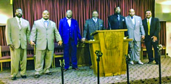 Ministers showing their unity are, from left, Christopher Mitchell, Conley Gibbs Jr., Leon Cobb, Roy Morgan, Rodney Weekly, Christopher Williams and Marvin Johnson.