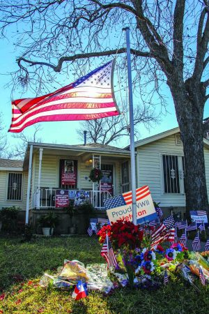American flags and flowers adorn the Austin home of Richard Overton. In May 2017, the city renamed the street he lived on for seven decades in his honor.