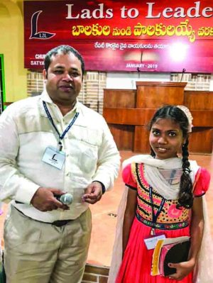 """Let me brag about Ganga,"" minister Ricky Gootam said of the 13-year-old convention participant. ""Today she told 262 Bible verses without looking."""
