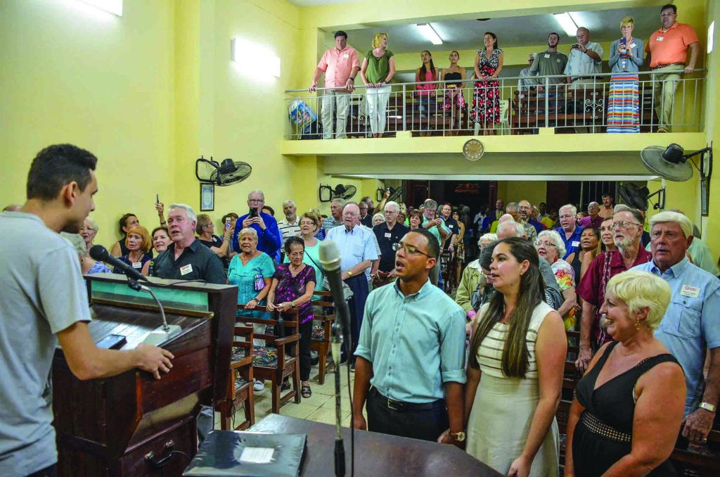 Cuban Christians join with their brethren from the U.S. for an evening devotional at the meeting place of the 10 de Octubre Iglesia de Cristo in Havana, Cuba. The congregation was one of the first Churches of Christ planted on the island by missionaries Ernesto Estévez and José Ricardo Jimenez, Floridians of Cuban descent, in 1938.
