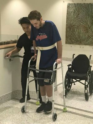 Slater Springman works to regain his strength following a heat stroke in Aug. 2018.