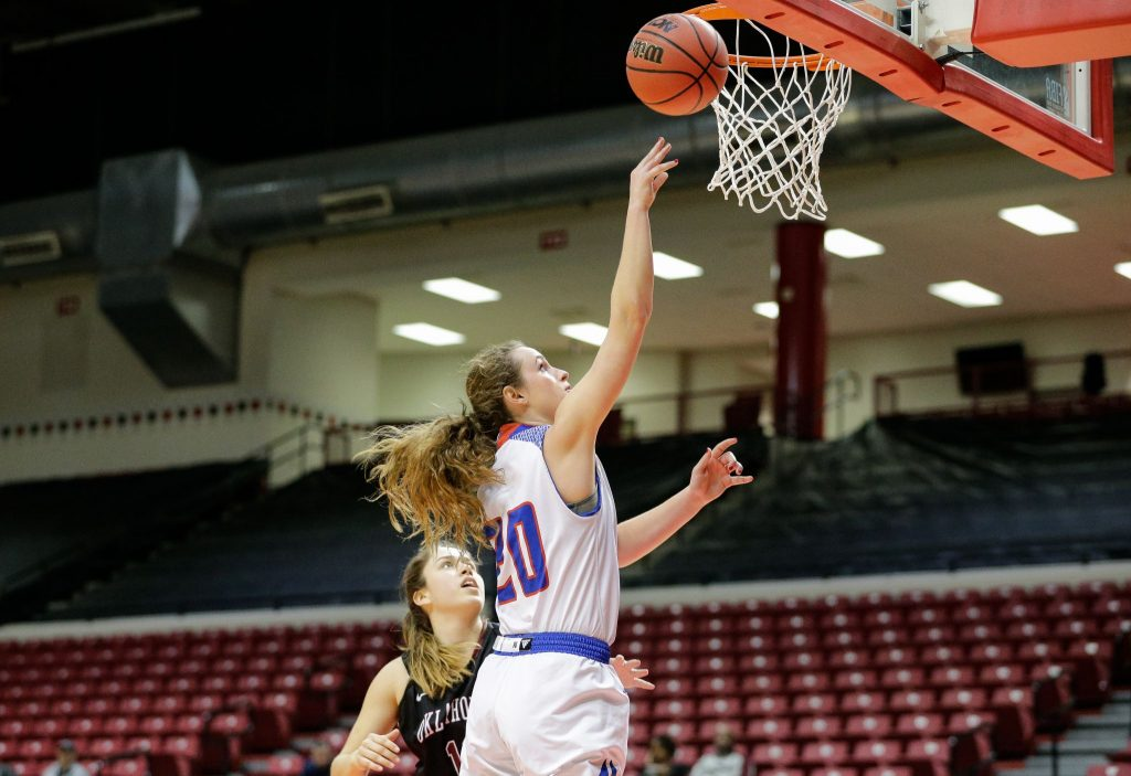 Olivia Robertson drives for a basket against Oklahoma Christian University earlier in the season.