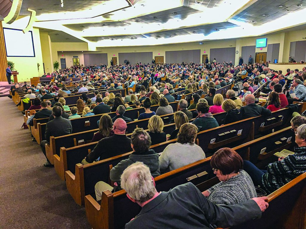"A packed auditorium listens as Jeremie Beller, congregational minister for the Wilshire Church of Christ in Oklahoma City, delivers a Saturday morning keynote, ""That They May All Be One,"" during the Affirming the Faith seminar."