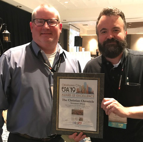 Chief Correspondent Bobby Ross, left, and Editor Erik Tryggestad, right, show off the Award of Excellence following the EPA's awards ceremony.