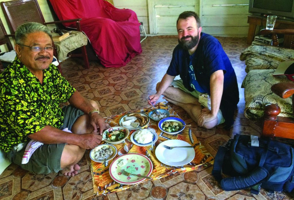 Mika Laufili, minister for the Vaimoso Church of Christ, treats Erik Tryggestad to a traditional Samoan lunch in his home in Apia, Samoa.