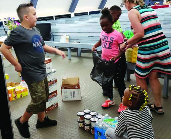 Children at the Pearl Harbor church organize items to share with the homeless.