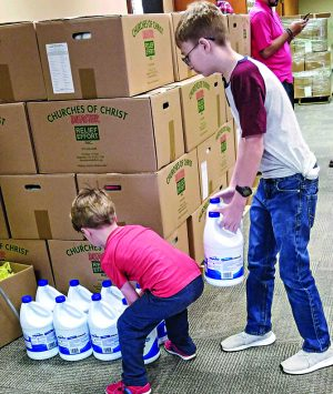 Volunteers at the Bellevue Church of Christ in Nebraska organize emergency supplies delivered by Churches of Christ Disaster Relief Effort.