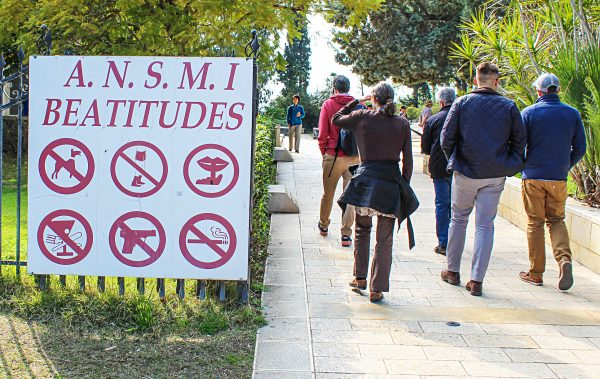 Blessed are those who don't bring guns to the Mount of Beatitudes. A sign outlining proper behavior greets tourists at the place where, according to tradition, Jesus delivered his famous Sermon on the Mount.