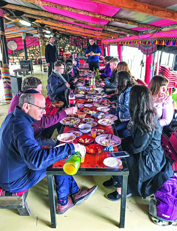 U.S. religion journalists enjoy a traditional lunch at a Bedouin tent while on a tour of Israel.