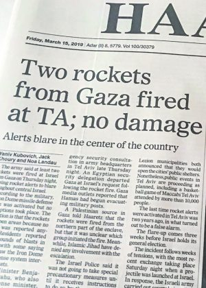 A headline in an Israeli newspaper reports no injuries or damages after a rocket attack from the Gaza Strip.
