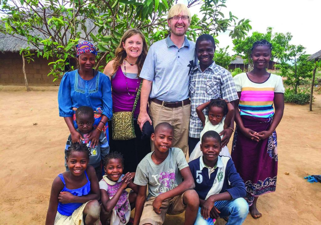 Rachel and Alan Howell stand with a few of the souls they and their three daughters served in the southern African nation of Mozambique.