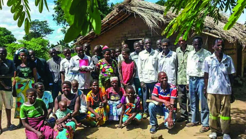Luis Pereira visits a congregation in the Mozambican village of Inhangoma. The cyclone destroyed the village's crops.